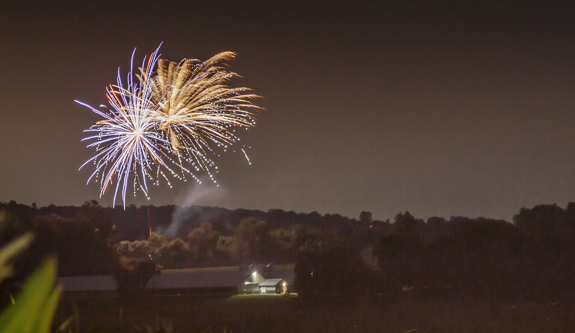 fireworks over a barn